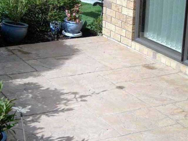 Tired and old stamped concrete before acid wash and re-finishing.