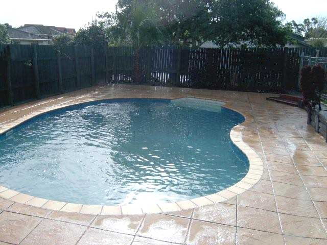 Kidney Shaped Pool With Tile Cut Concrete Patio